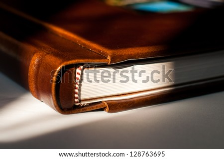 Detail of a leather photography album cover - stock photo