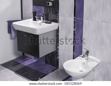 detail of a luxurious bathroom with sink and bidet in three colors - stock photo