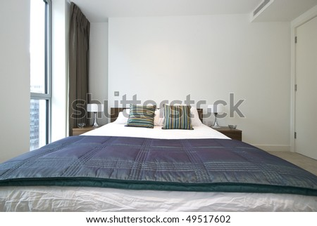 Detail of a luxurious modern bedroom with beautiful bedding and decorations - stock photo