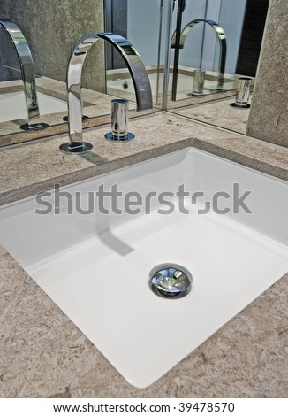 detail of a luxury modern hand wash basin in brown marble - stock photo