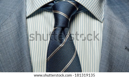 Detail of a man's business suit. tie and a shirt - stock photo