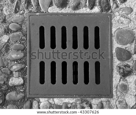 Detail of a manhole grid in the street - stock photo