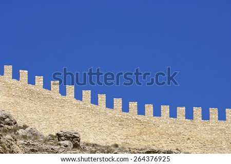 Detail of a medieval stone wall in Albarracin, Teruel, Aragon, Spain. - stock photo