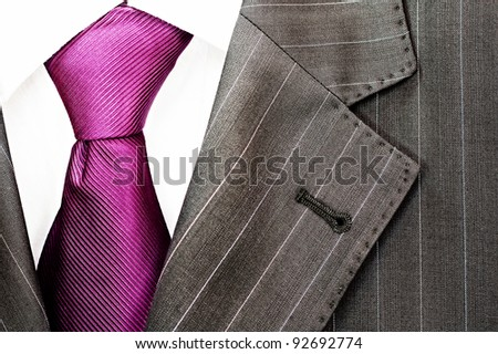 Detail of a men's striped business suit.Pink tie and a shirt - stock photo