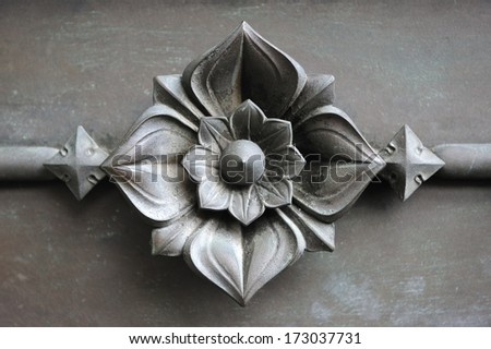 detail of a metal flower art work in wrought iron - stock photo