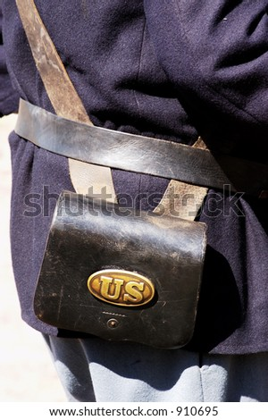 Detail of a military uniform on display during a civil war battle enactment. - stock photo