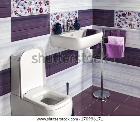 detail of a modern bathroom with sink, toilet and accessories - stock photo