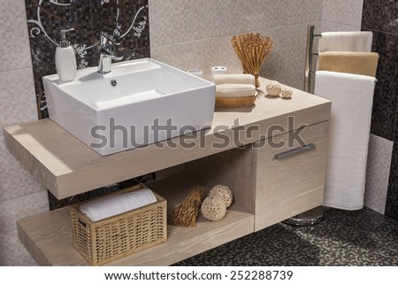 detail of a modern bathroom with white sink and towels - stock photo