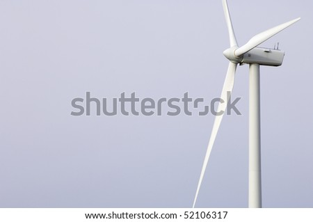 detail of a modern windmill and white sky - stock photo