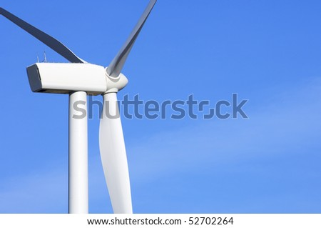 detail of a modern windmill with blue sky - stock photo