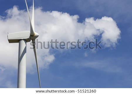 detail of a modern windmill with cloudy sky - stock photo