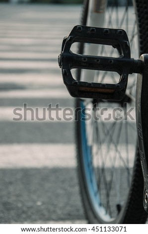 Detail of a Mountain Bike Tire with Four Lights in the Background (vintage style) - stock photo