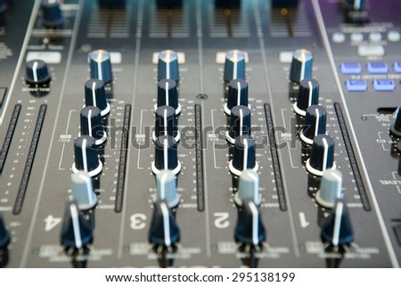 Detail of a music mixer in studio, dj working for a new song