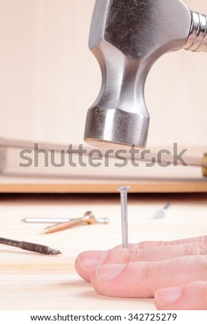 detail of a nail and a hammer