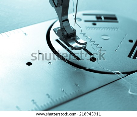 Detail of a needle in a sewing machine - cool cyanotype - stock photo