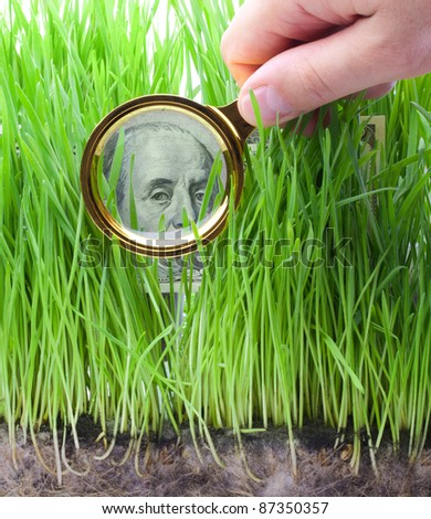 Detail of a One Hundred Dollar Bill Through a Magnifying Glass. - stock photo