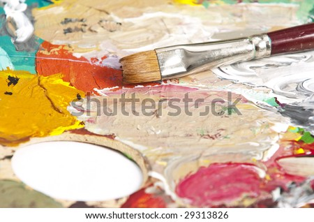 Detail of a paintbrush on an artist's palette
