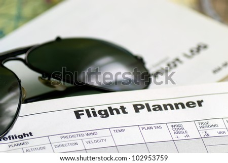 detail of a pair of aviator sunglasses on a flight planner