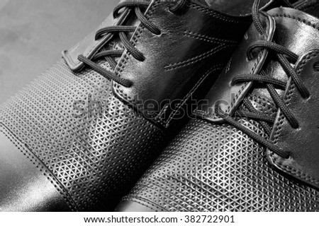 Detail of a pair of luxurious men's leather shoes, B&W. - stock photo