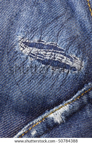 detail of a patch in blue jeans - stock photo