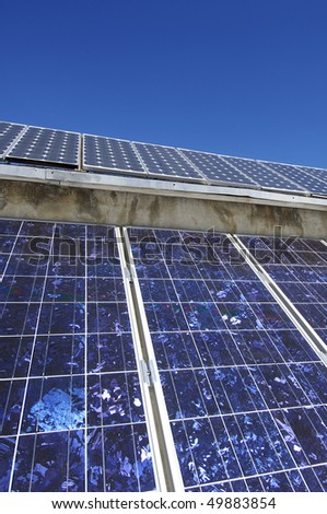 detail of a photovoltaic panel located on the roof of a building - stock photo