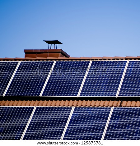 Detail of a photovoltaic system on a roof. - stock photo