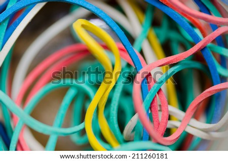 Detail of a pile of multicolored rubber bands.