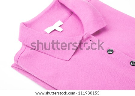 Detail of a pink polo shirt. - stock photo