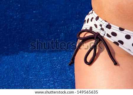 detail of a polka dot bikini - stock photo