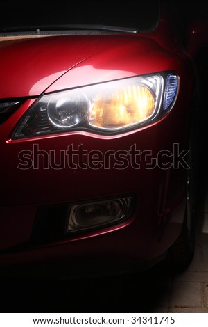 detail of a red car - stock photo
