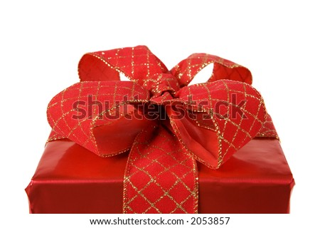 detail of a red gift with a big red and golden bow on white - stock photo