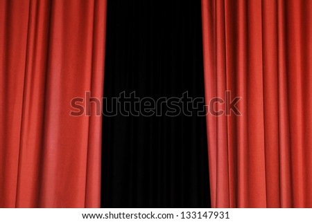 Detail of a red rising curtain in a theater - stock photo