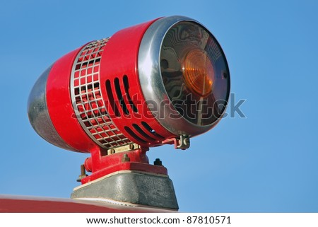 Detail of a Red siren over a firefighters vehicle - stock photo