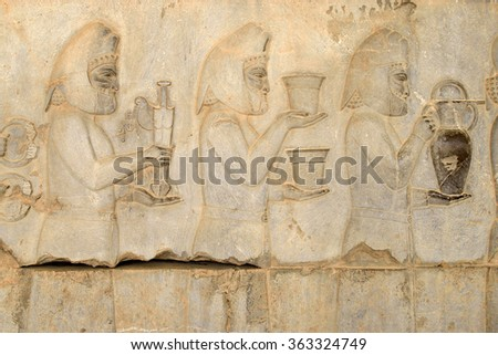 Detail of a relief of the eastern stairs in Persepolis in Iran. UNESCO declared the ruins of Persepolis a World Heritage Site in 1979. - stock photo