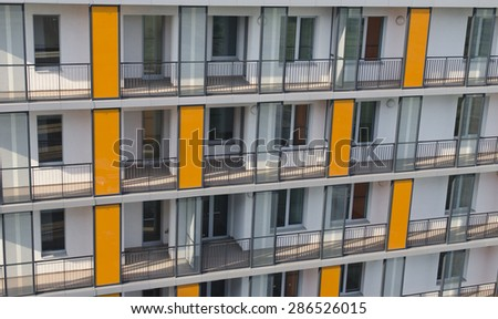 Detail of a residential building with apartments in foreground. - stock photo
