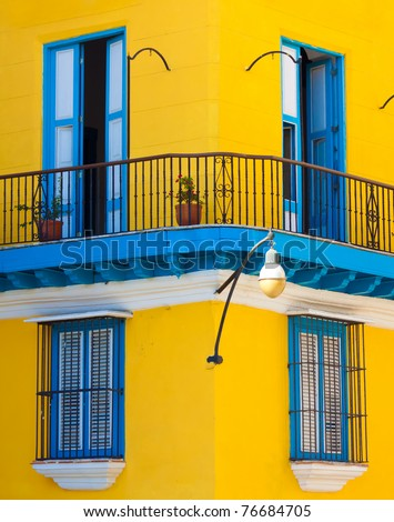 Detail of a restored colonial building in Old Havana with typical caribbean doors and balconies - stock photo