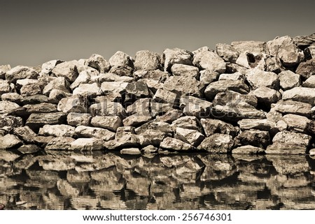 Detail of a Rock Wall - concept image - sepia toned - stock photo