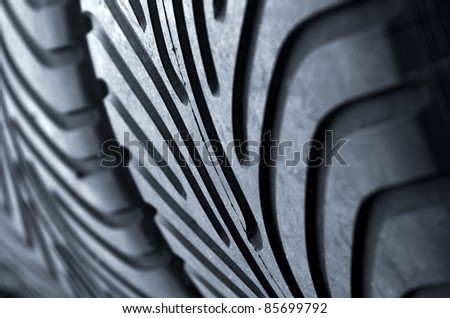 Detail of a row of new racing motor-sport tires is a garage - stock photo