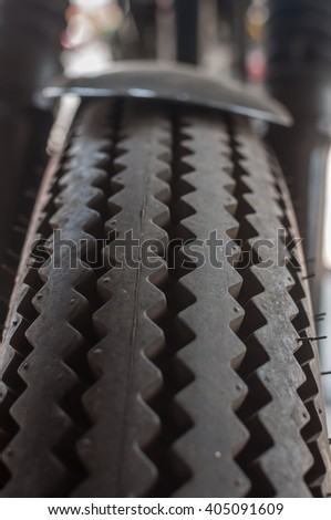 Detail of a row of new racing motor-sport tires is a garage,close up - stock photo