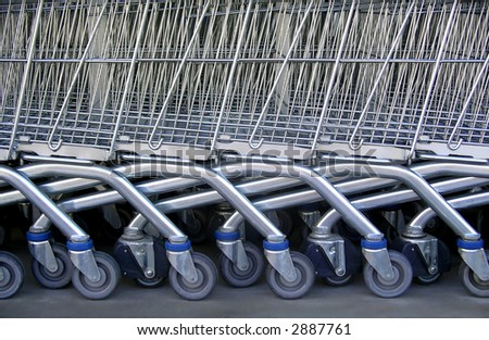 Detail of a row of supermarket karts tidy put together. - stock photo