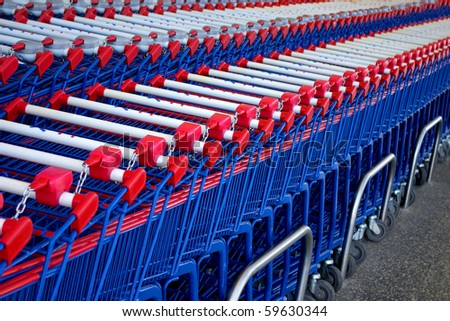 Detail of a rows of supermarket karts tidy put together. - stock photo
