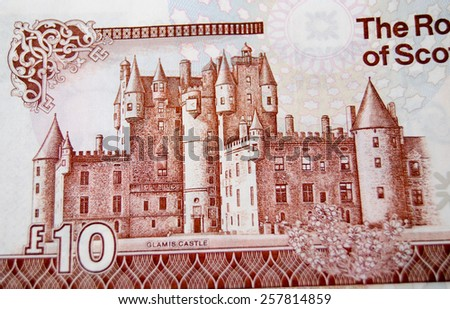 Detail of a Royal Bank of Scotland ten pound note showing Glamis Castle.  Reputedly the site of Macbeth's murder of King Malcolm II.  Used banknote photographed at an angle, less than 80% of note. - stock photo