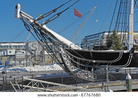 "detail of a sailing ship named ""USS Constitution"" anchoring in Boston (Massachusetts, USA) in sunny ambiance at winter time - stock photo"