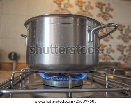 Detail of a saucepot on a gas cooker - stock photo