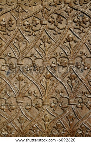 Detail of a sculpture in wood on a front gate - Horezu Monastery - stock photo