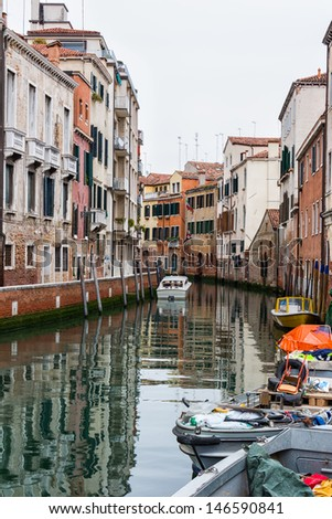 Detail of a small canal in Venice, Italy - stock photo