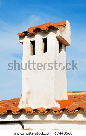 detail of a smokestack on a mediterranean villa - stock photo