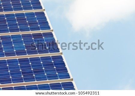 Detail of a solar panel against a blue sky