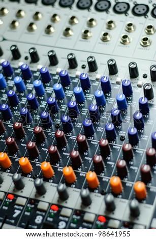 detail of a sound mixer - stock photo