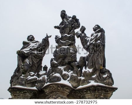 detail of a statue situated on the charles bridge in prague.